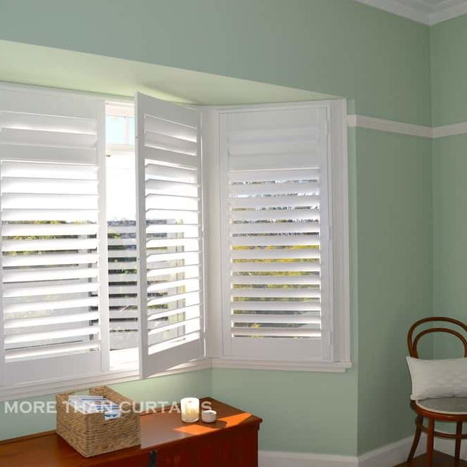 Painted hardwood plantation shutters on a bay window