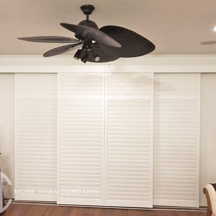 Painted hardwood sliding plantation shutters