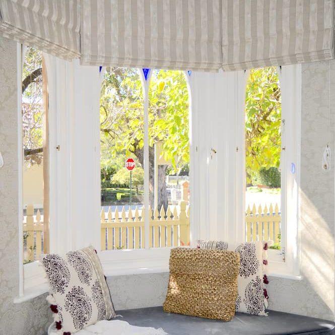 Striped Roman blinds in a bay window