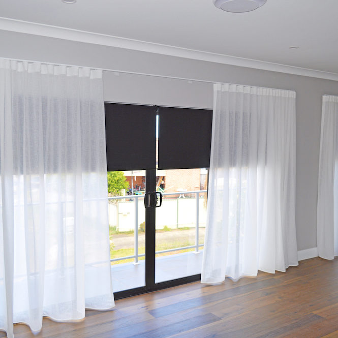White sheer s-fold curtains & black blockout roller blinds